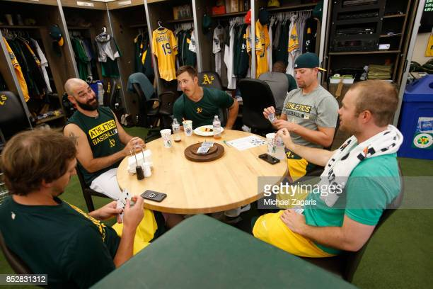 Ryan Dull Chris Hatcher Daniel Mengden Blake Treinen and Daniel Coulombe of the Oakland Athletics play cards in the clubhouse prior to the game...