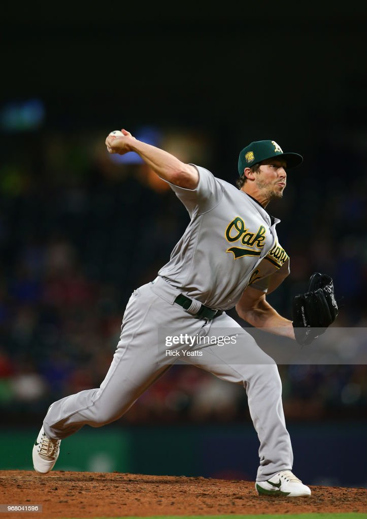 Ryan Dull #66 of the Oakland Athletics throws in the sixth inning against the Texas Rangers at Globe Life Park in Arlington on June 5, 2018 in Arlington, Texas.