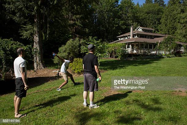 Ryan Duncan a counselor Nikhil and Anthony play bocce at reSTART a rehabilitation center for digital media addiction in Fall City Washington on May...