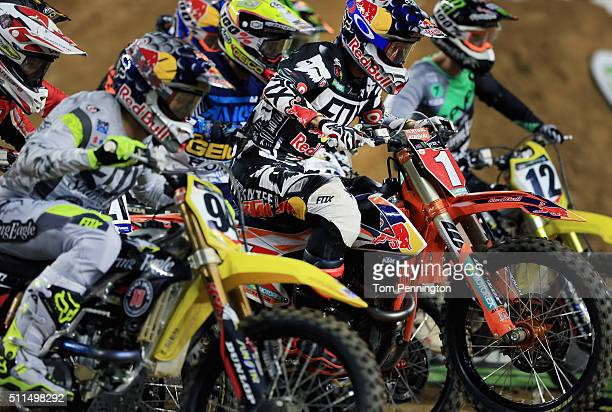 Ryan Dungey rider of the KTM 450 SX-F Factory Edition battles Ken Roczen rider of the Suzuki RM-Z450 for the hole shot during the 450SX Main during...