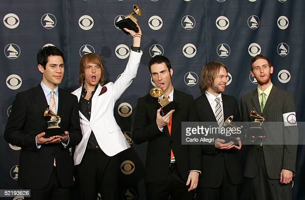 """Ryan Dusik, Mickey Madden, Adam Levine, Jesse Carmichael, and James Valentine of Maroon 5 pose backstage with their award for """"Best New Artist""""..."""