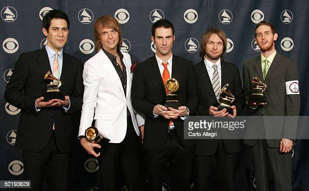 Ryan Dusik Mickey Madden Adam Levine Jesse Carmichael and James Valentine of Maroon 5 pose backstage with their award for Best New Artist during the...