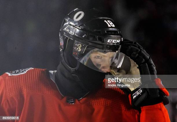 Ryan Dzingel of the Ottawa Senators adjusts his visor during a stoppage in play against the Montreal Canadiens during the 2017 Scotiabank NHL100...