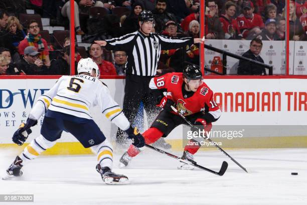 Ryan Dzingel of the Ottawa Senators battles for the loose puck against Marco Scandella of the Buffalo Sabres at Canadian Tire Centre on February 15...