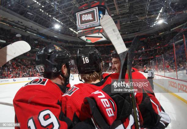 Ryan Dzingel of the Ottawa Senators celebrates his first period goal against the San Jose Sharks with teammates Derick Brassard and Mark Stone at...