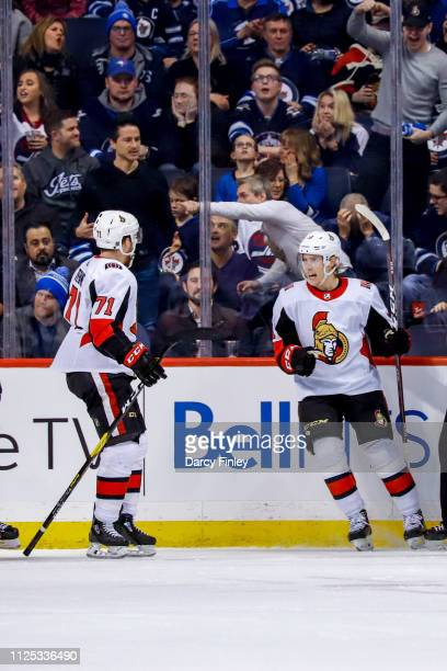Ryan Dzingel of the Ottawa Senators celebrates his overtime winning goal against the Winnipeg Jets with teammate Chris Tierney at the Bell MTS Place...