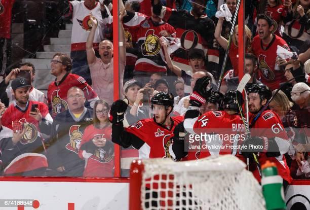 Ryan Dzingel of the Ottawa Senators celebrates his second period powerplay goal against the New York Rangers with teammates Kyle Turris Alexandre...