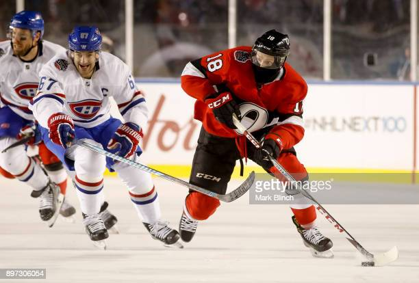 Ryan Dzingel of the Ottawa Senators controls the puck against Max Pacioretty of the Montreal Canadiens during the 2017 Scotiabank NHL 100 Classic at...