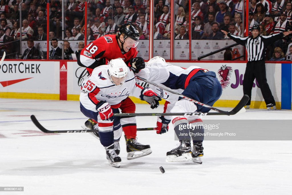 Ryan Dzingel #18 of the Ottawa Senators gets blocks by Aaron Ness #55 of the Washington Capitals in the third period at Canadian Tire Centre on October 5, 2017 in Ottawa, Ontario, Canada.