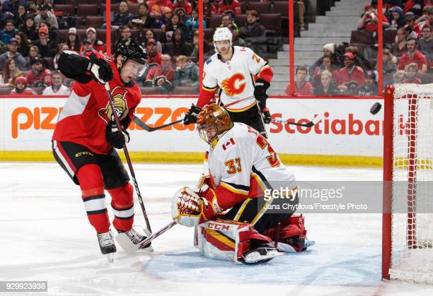 Ryan Dzingel of the Ottawa Senators has his shot graze the post as David Rittich of the Calgary Flames guards the net in the second period at...
