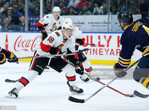 Ryan Dzingel of the Ottawa Senators shoots the puck as Josh Gorges of the Buffalo Sabres defends during the first period at the KeyBank Center on...