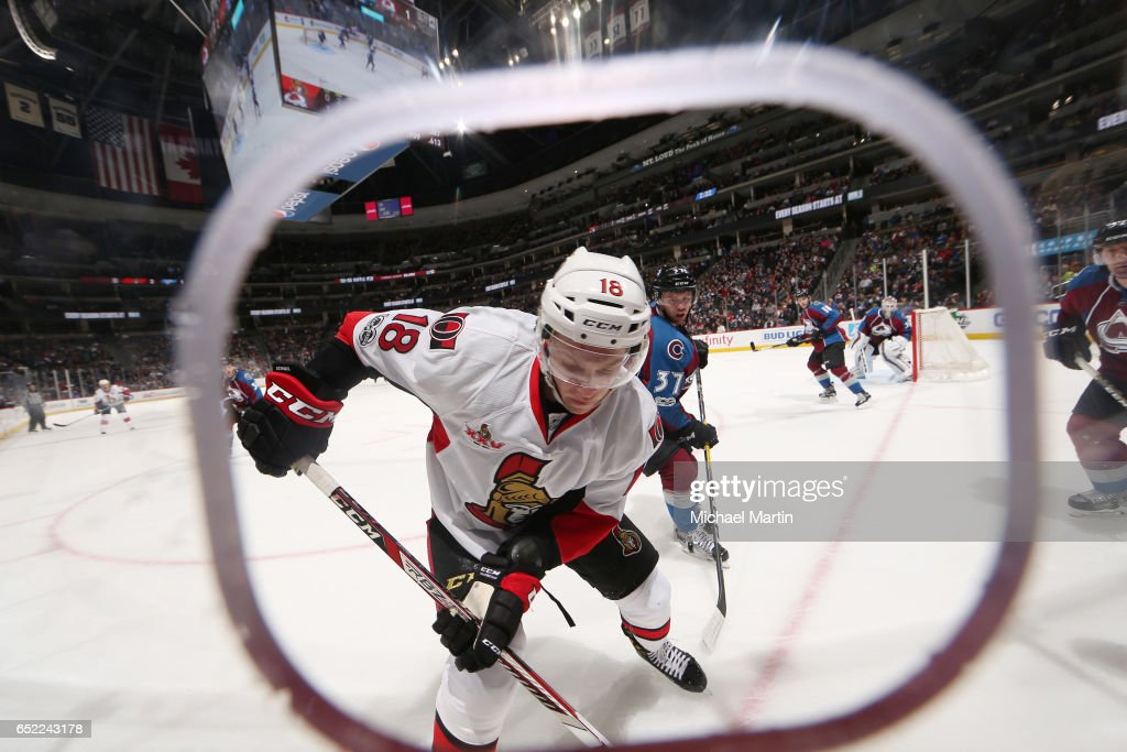 Ryan Dzingel #18 of the Ottawa Senators skates against J.T. Compher #37 of the Colorado Avalanche at the Pepsi Center on March 11, 2017 in Denver, Colorado.