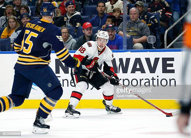 Ryan Dzingel of the Ottawa Senators skates with the puck as Rasmus Ristolainen of the Buffalo Sabres defends during the first period at the KeyBank...