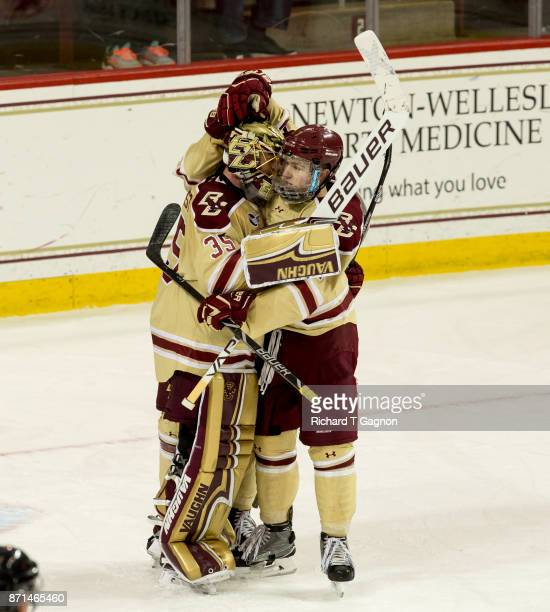 Ryan Edquist of the Boston College Eagles and teammate Connor Moore celebrate a 21 victory against the Connecticut Huskies during NCAA hockey at...