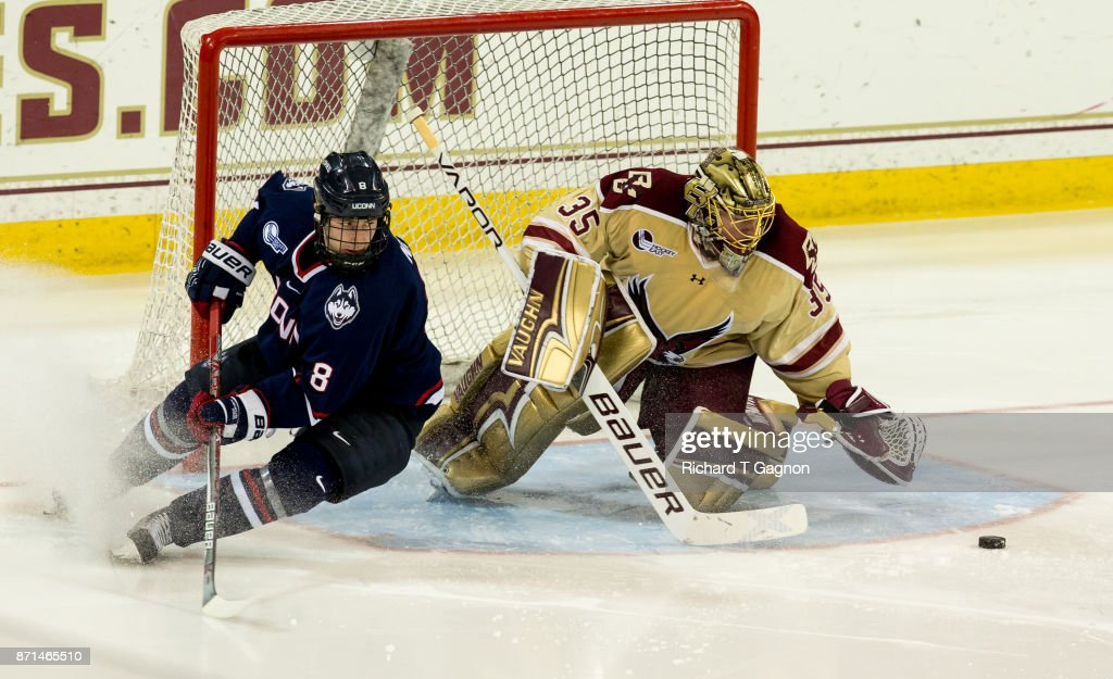 Ryan Edquist #35 of the Boston College Eagles makes a save against Spencer Naas #8 of the Connecticut Huskies during NCAA hockey at Kelley Rink on November 7, 2017 in Chestnut Hill, Massachusetts. The Eagles won 2-1.
