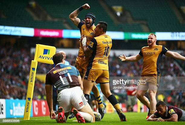 Ryan Edwards of Bristol Rugby celebrates scoring his team's third try with Tusi Pisi during the Aviva Premiership match between Harlequins and...
