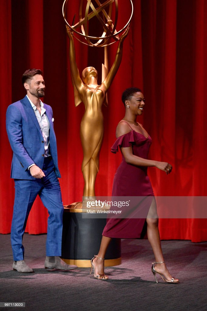 Ryan Eggold (L) and Samira Wiley walk onstage during the 70th Emmy Awards Nominations Announcement at Saban Media Center on July 12, 2018 in North Hollywood, California.