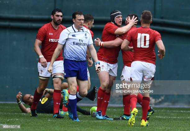 Ryan Elias of Wales is congratulated by teammates after scoring against South Africa in the friendly Wales v South After Rugby match at RFK Stadium...