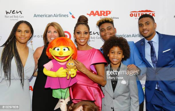 Ryan Elizabeth Peete Host Holly Robinson Peete Roman Peete Rodney Peete Jr Robinson James Peete pose with the first autistic Sesame Street character...