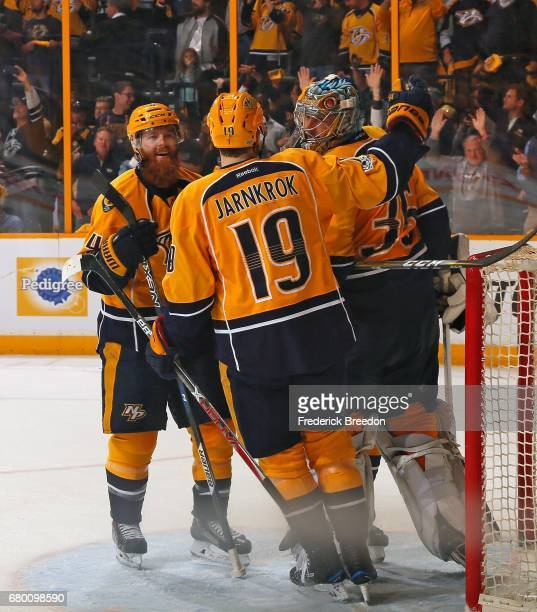 Ryan Ellis and Calle Jarnkrok congratulate goalie Pekka Rinne after a 31 Predator victory over the St Louis Blues in Game Six of the Western...