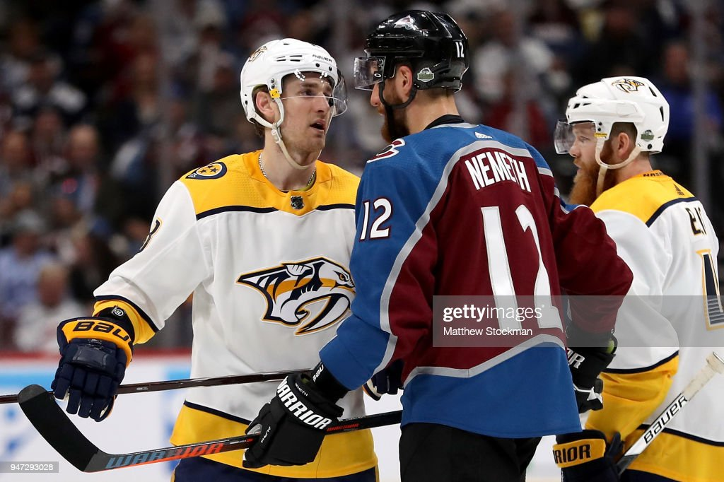 Ryan Ellis #4 and Kyle Turris #7 of the Nashville Predators exchange words with Patrik Nemeth #12 of the Colorado Rockies in Game Three of the Western Conference First Round during the 2018 NHL Stanley Cup Playoffs at the Pepsi Center on April 16, 2018 in Denver, Colorado.