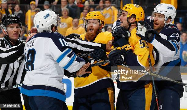 Ryan Ellis and Roman Josi of the Nashville Predators argue with Bryan Little and Blake Wheeler of the Winnipeg Jets during an NHL game at Bridgestone...