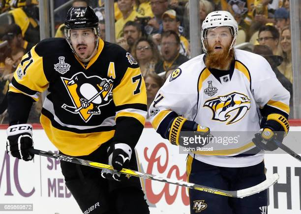 Ryan Ellis of the Nashville Predators and Evgeni Malkin of the Pittsburgh Penguins play in the first period of Game One of the 2017 NHL Stanley Cup...