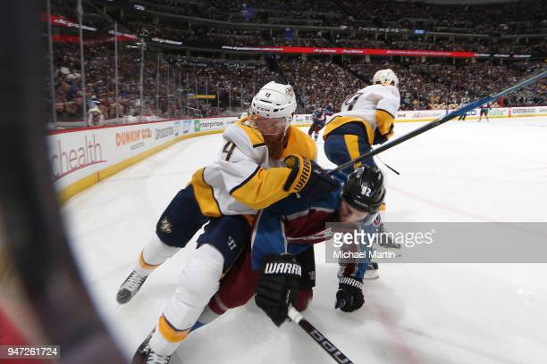 Ryan Ellis of the Nashville Predators battles for position against Gabriel Landeskog of the Colorado Avalanche in Game Three of the Western...
