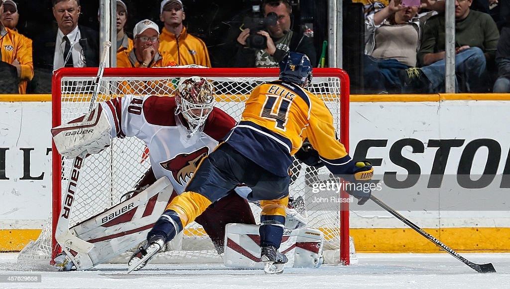 Ryan Ellis #4 of the Nashville Predators beats Devan Dubnyk #40 of the Arizona Coyotes on the glove side for the shoot-out, game-winning goal at Bridgestone Arena on October 21, 2014 in Nashville, Tennessee.