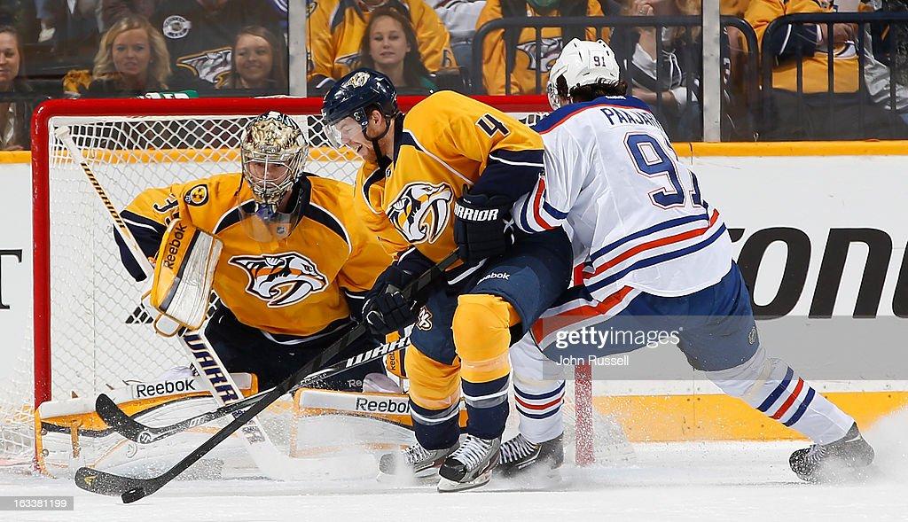 Ryan Ellis #4 of the Nashville Predators blocks a shot in front of goalie Pekka Rinne #35 against Magnus Paajarvi #91 of the Edmonton Oilers during an NHL game at the Bridgestone Arena on March 8, 2013 in Nashville, Tennessee.