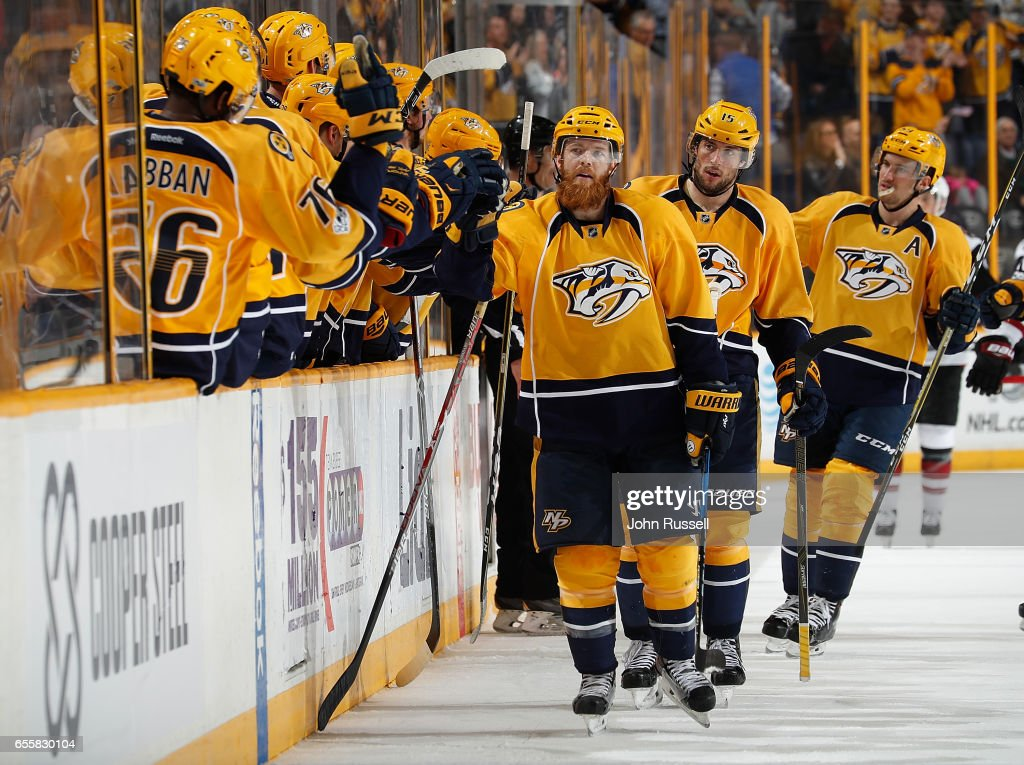 Ryan Ellis #4 of the Nashville Predators celebrates his goal along the bench with Craig Smith #15 against the Arizona Coyotes during an NHL game at Bridgestone Arena on March 20, 2017 in Nashville, Tennessee.