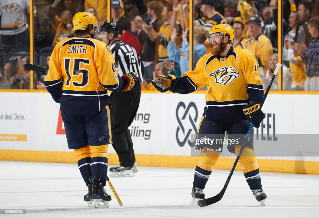 Ryan Ellis #4 of the Nashville Predators celebrates his goal with Craig Smith #15 against the Arizona Coyotes during an NHL game at Bridgestone Arena on March 20, 2017 in Nashville, Tennessee.