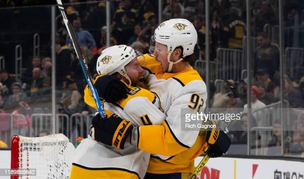 Ryan Ellis of the Nashville Predators celebrates his overtime goal against the Boston Bruins with teammate Ryan Johansen at TD Garden on December 21,...