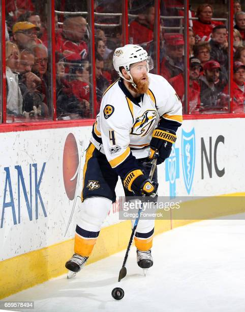Ryan Ellis of the Nashville Predators controls a puck along the boards during an NHL game against the Carolina Hurricanes on March 18 2017 at PNC...