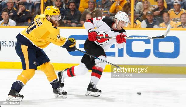 Ryan Ellis of the Nashville Predators defends against Blake Coleman of the New Jersey Devils during an NHL game at Bridgestone Arena on March 10 2018...