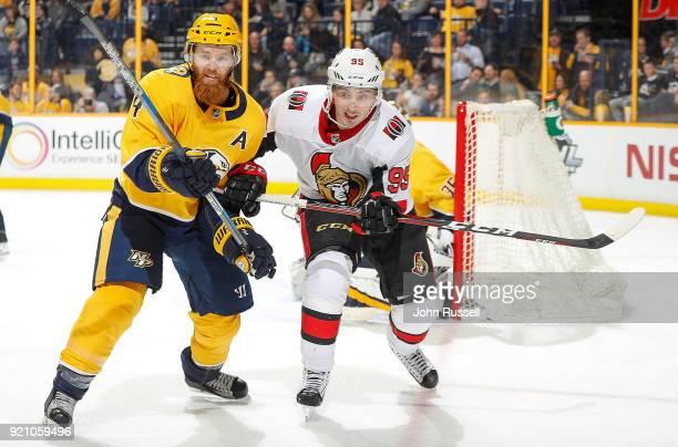Ryan Ellis of the Nashville Predators defends against Matt Duchene of the Ottawa Senators during an NHL game at Bridgestone Arena on February 19 2018...