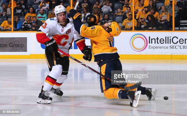 Ryan Ellis of the Nashville Predators draws a four minute penalty against Sean Monahan of the Calgary Flames during the second period at Bridgestone...