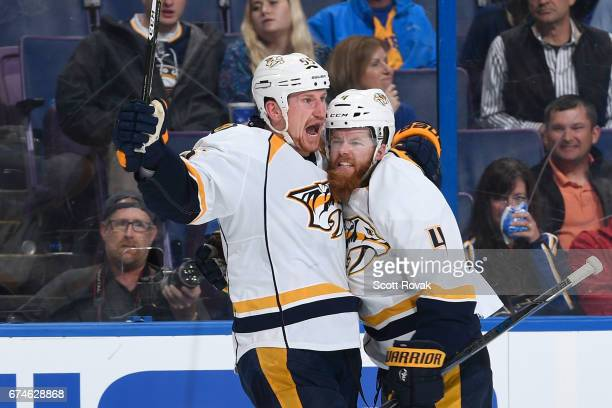 Ryan Ellis of the Nashville Predators is congratulated by Cody McLeod of the Nashville Predators after scoring a goal against the St Louis Blues in...