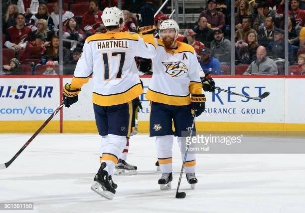 Ryan Ellis of the Nashville Predators is congratulated by teammate Scott Hartnell after his second period goal against the Arizona Coyotes at Gila...