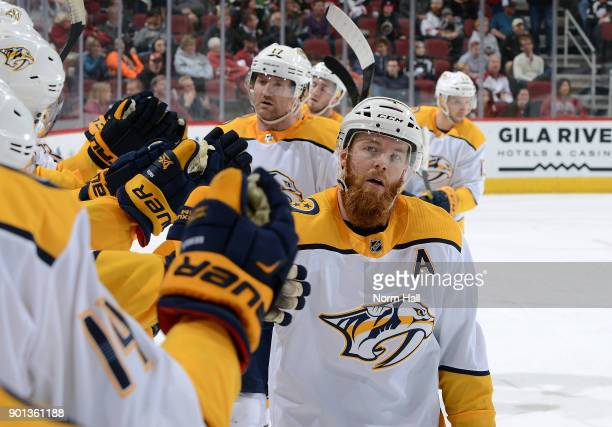 Ryan Ellis of the Nashville Predators is congratulated by teammates after his second period goal against the Arizona Coyotes at Gila River Arena on...