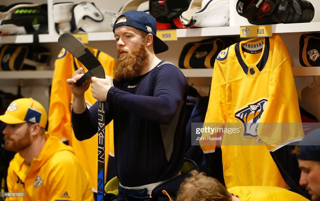 Ryan Ellis #4 of the Nashville Predators prepares his stick prior to an NHL game against the Columbus Blue Jackets at Bridgestone Arena on April 7, 2018 in Nashville, Tennessee.
