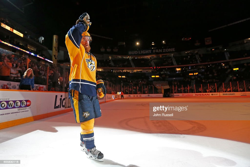 Ryan Ellis #4 of the Nashville Predators salutes the fans as First Star of the game with two goals against the Arizona Coyotes during an NHL game at Bridgestone Arena on March 20, 2017 in Nashville, Tennessee.