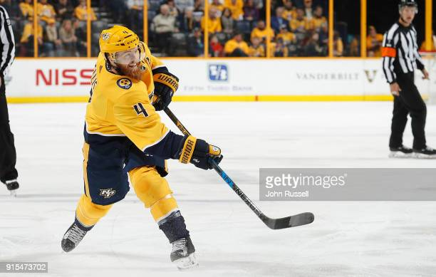 Ryan Ellis of the Nashville Predators shoots the puck against the New York Rangers during an NHL game at Bridgestone Arena on February 3 2018 in...