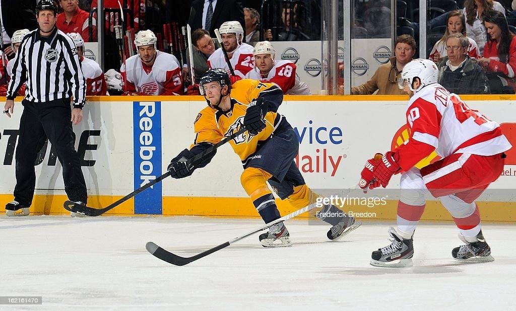 Ryan Ellis #4 of the Nashville Predators skates against Henrik Zetterberg #40 of the Detroit Red Wings at the Bridgestone Arena on February 19, 2013 in Nashville, Tennessee.