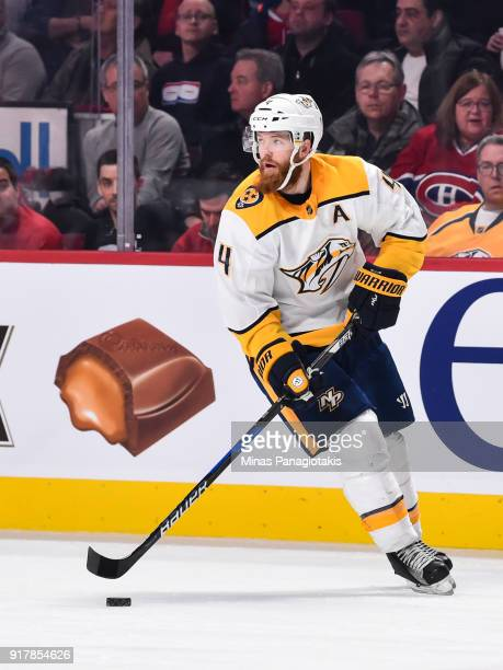 Ryan Ellis of the Nashville Predators skates the puck against the Montreal Canadiens during the NHL game at the Bell Centre on February 10 2018 in...