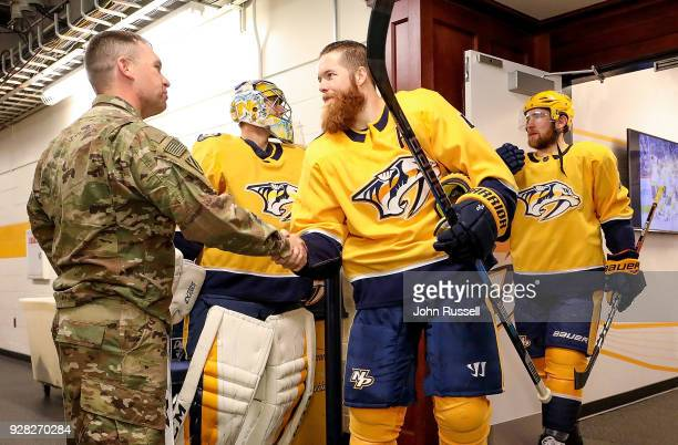 Ryan Ellis of the Nashville Predators thanks Major Adam Moore for his service to the country during Military Week prior to an NHL game against the...