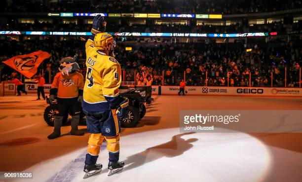 Ryan Ellis of the Nashville Predators waves as First Star of the Game after shootout win against the Arizona Coyotes during an NHL game at...