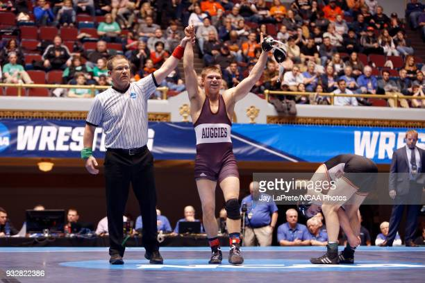 Ryan Epps of Augsburg is declared the winner after defeating Logan Thomsen of Wartburg in the 157 weight class during the Division III Men's...