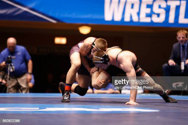 Ryan Epps of Augsburg wrestles Logan Thomsen of Wartburg in the 157 weight class during the Division III Men's Wrestling Championship held at the...