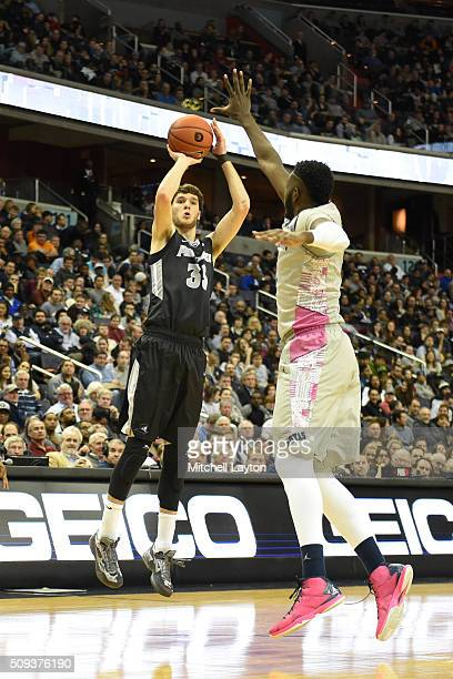 Ryan Fazekas of the Providence Friars takes a shot over Jessie Govan of the Georgetown Hoyas during a college basketball game at the Verizon Center...